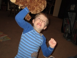 The exuberant 5-year-old shakes the monkey...